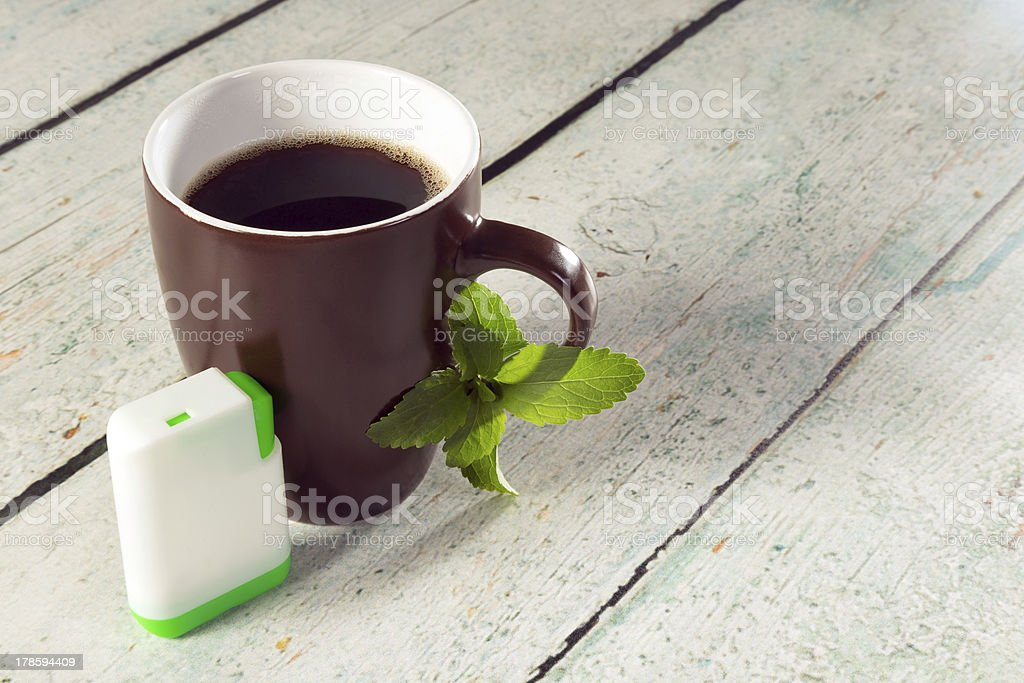 Box of stevia tablets and coffee stock photo