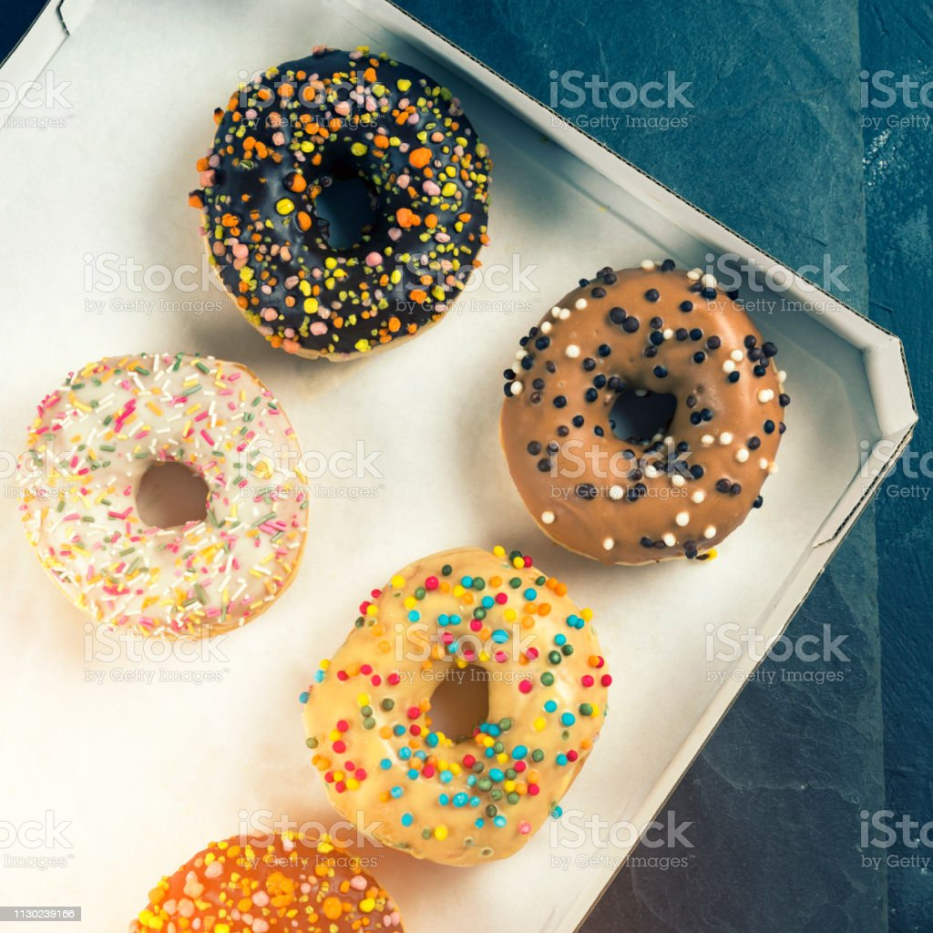 box of sweet fresh donuts with filling.