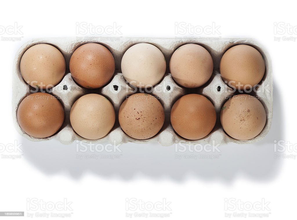 Box of ten brown eggs, isolated royalty-free stock photo