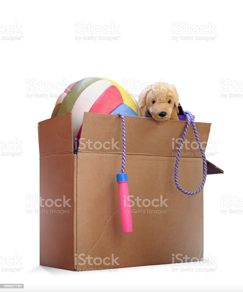 Box of used toys for a donation to charitable organizations stock photo