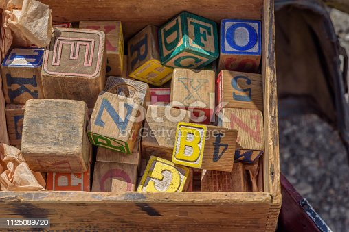 Closeup of Antique toy letter wooden blocks in box