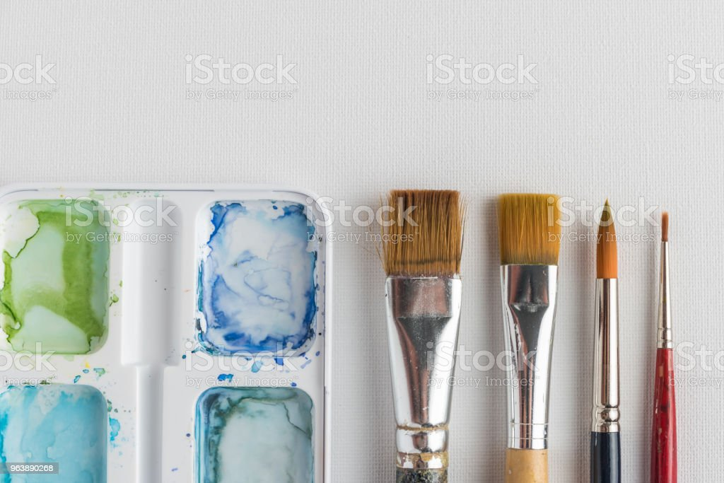 Box of watercolor paints and brushes - Royalty-free Art Stock Photo