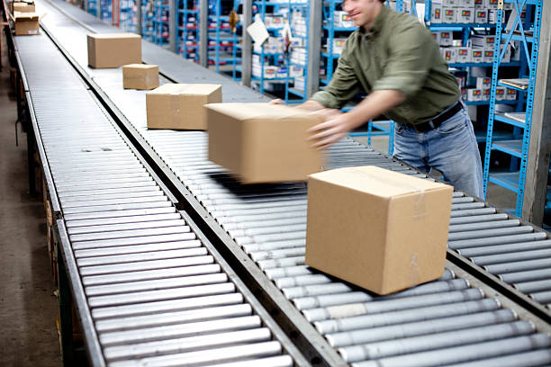 box on a conveyer belt - conveyor belt stock photos and pictures