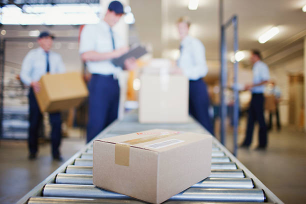 box on conveyor belt in shipping area - conveyor belt stock pictures, royalty-free photos & images
