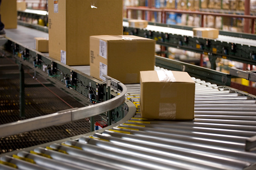 Boxes making their way down the conveyor belt on their way to customers.