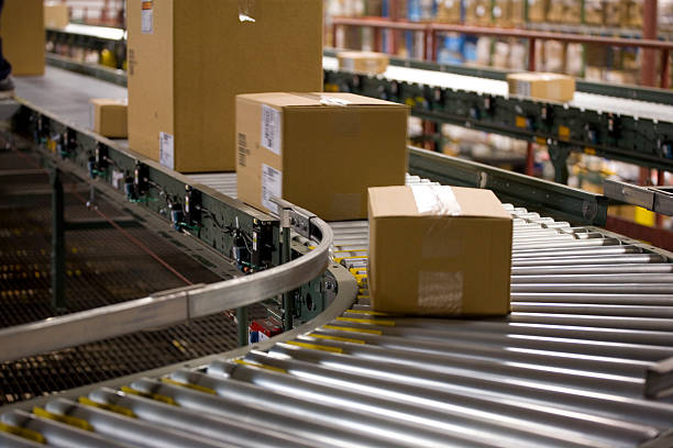 box - shipping in a warehouse - conveyor belt stock pictures, royalty-free photos & images