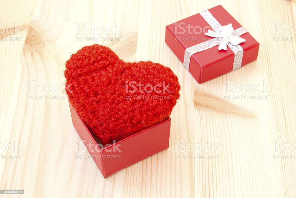 box with a cute red knitted heart royalty-free stock photo