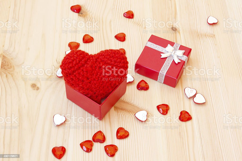 box with a cute red knitted valentine's heart royalty-free stock photo