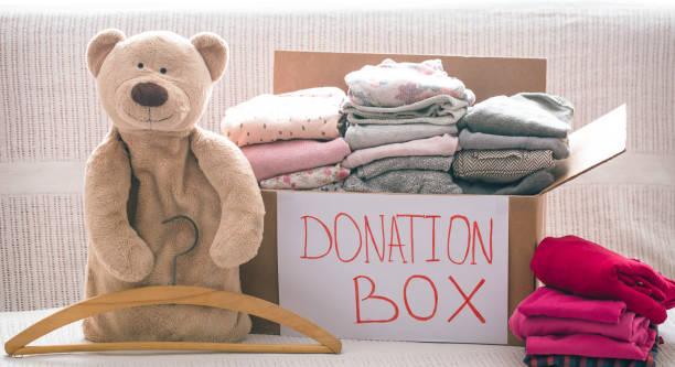 box with clothes for charity - oggetti personali foto e immagini stock