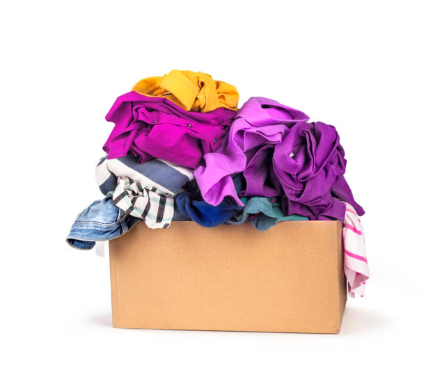 Box with clothes Box with clothes on white background. clothes in box stock pictures, royalty-free photos & images