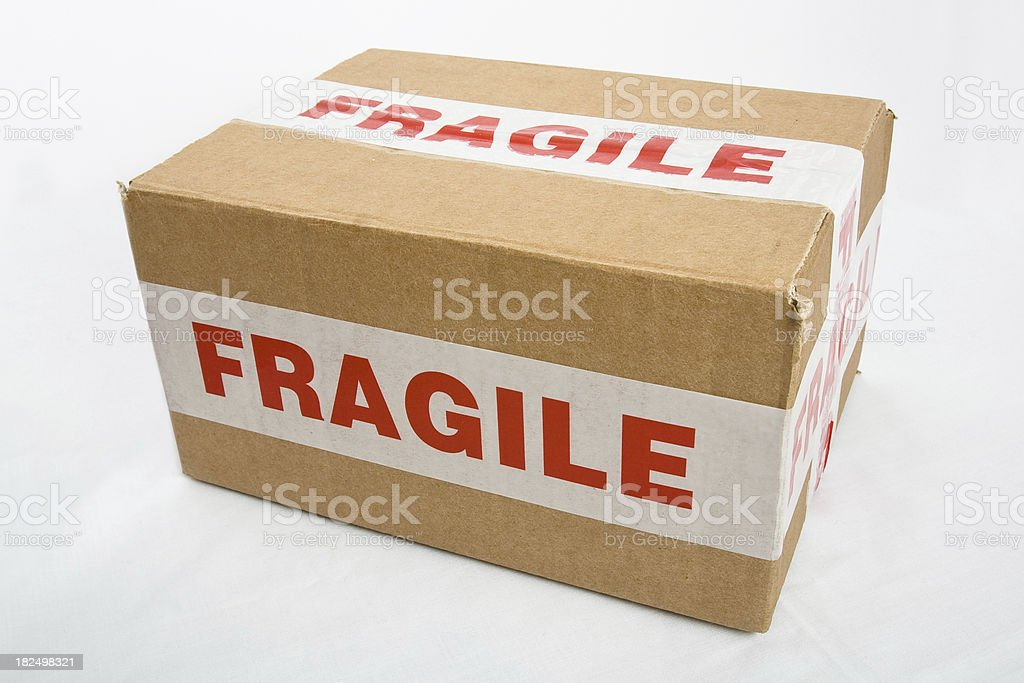 Box with fragile tape stock photo