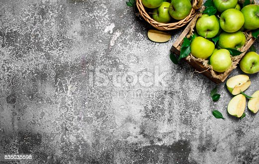 istock box with fresh, green apples. 835035598