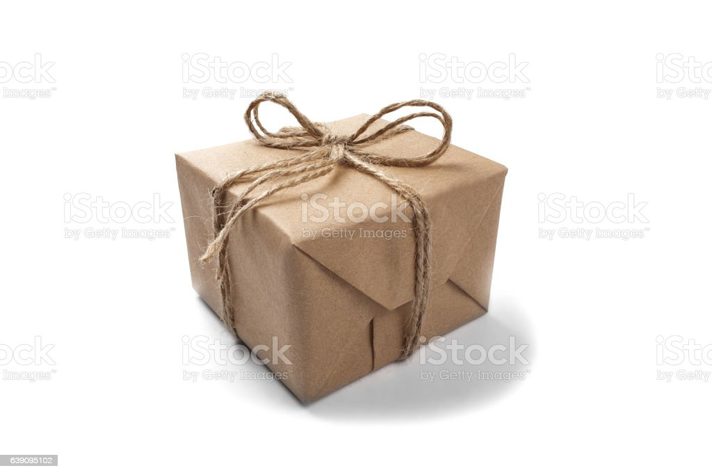 Box with gift wrapped in Kraft paper on white background stock photo