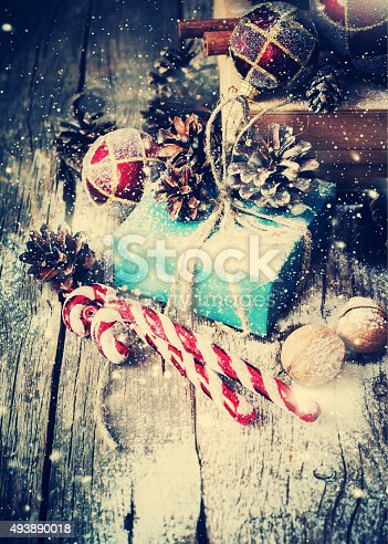 493890050 istock photo Box with Gifts on Wooden Background. Drawn Snow 493890018