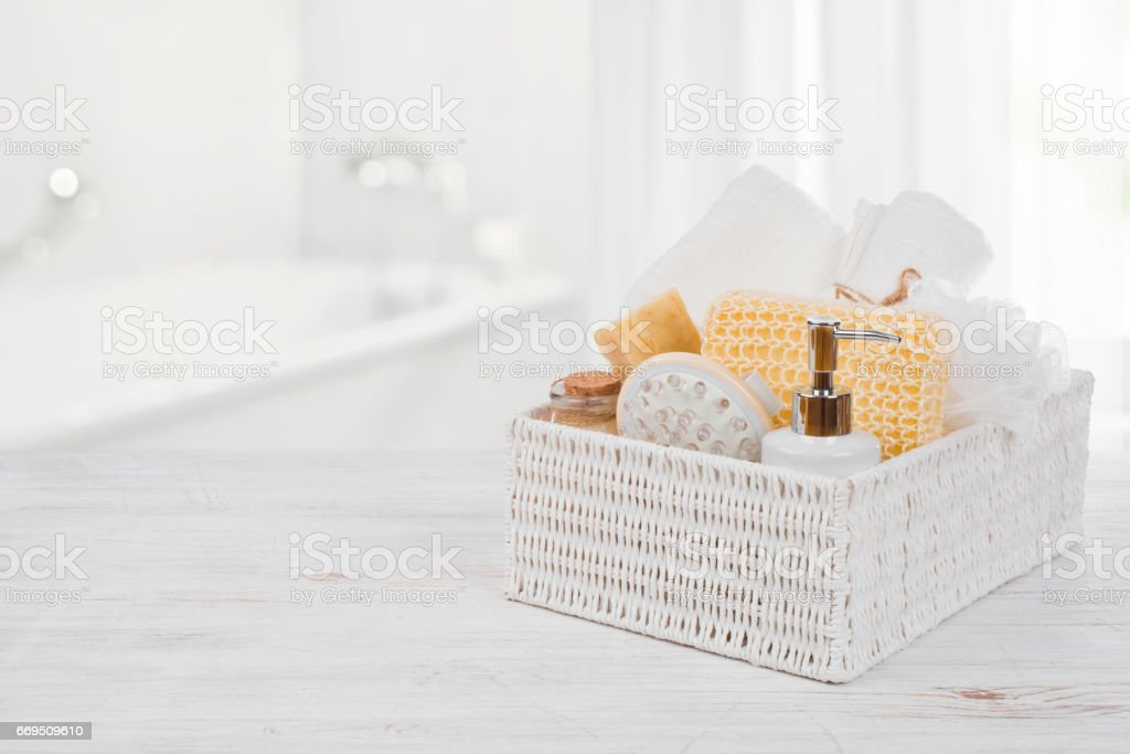 Box with spa products on wood over blurred bathroom interior - foto de acervo