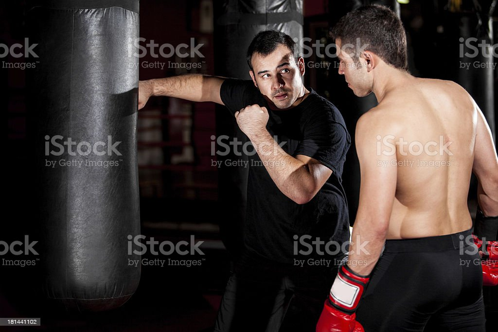 Boxer and coach training at a gym - Royalty-free 20-29 Years Stock Photo