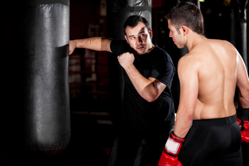 Boxer And Coach Training At A Gym Stock Photo - Download Image Now