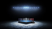 istock 3D boxer arena. Isolated empty boxing ring with light. 3D rendering. Boxing ring with illuminated spotlights 1276519377