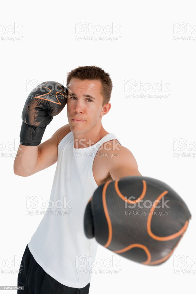 Boxer attacking with his left fist stock photo
