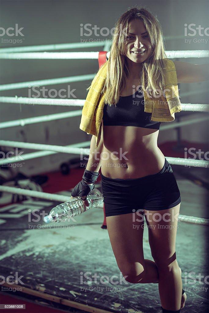 Boxer girl drinking water stock photo