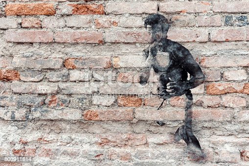 istock Boxer graffiti on old brick wall 803911614