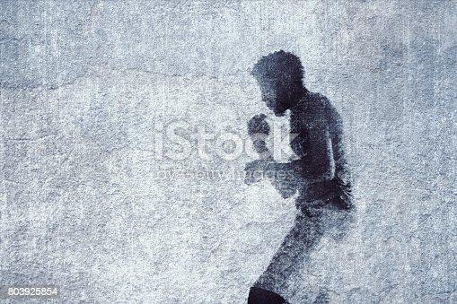 istock Boxer graffiti on old brick wall 803925854
