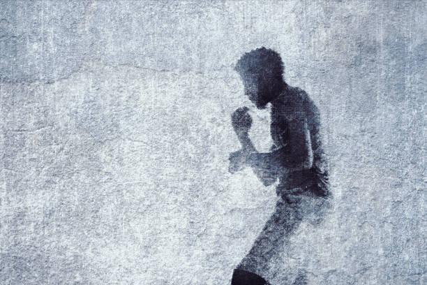 Graffiti de boxeador en pared de ladrillo viejo - foto de stock