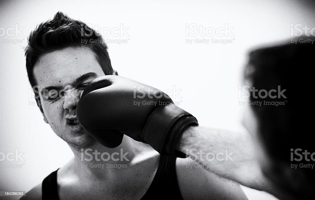 Boxer hit hard during a match stock photo