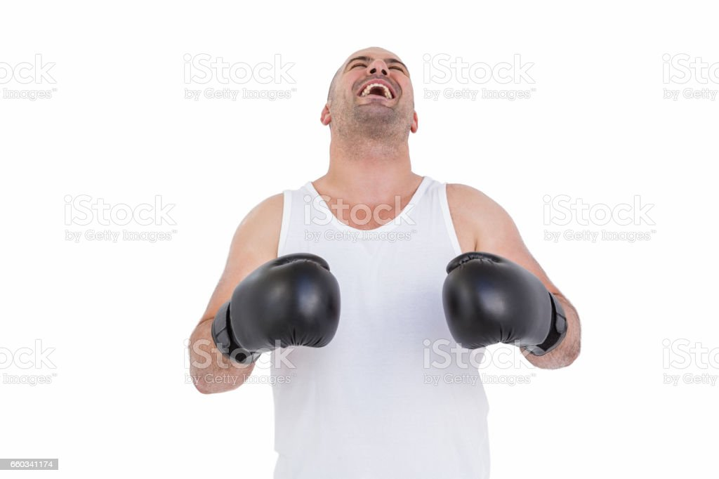 Boxer in boxing gloves laughing stock photo