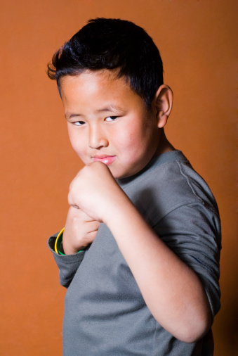 young kid in boxing stance (ready to fight)