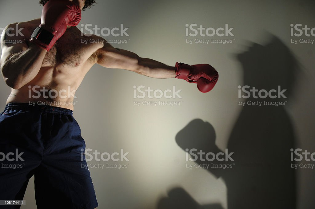 Boxer Knocking Out Shadow royalty-free stock photo