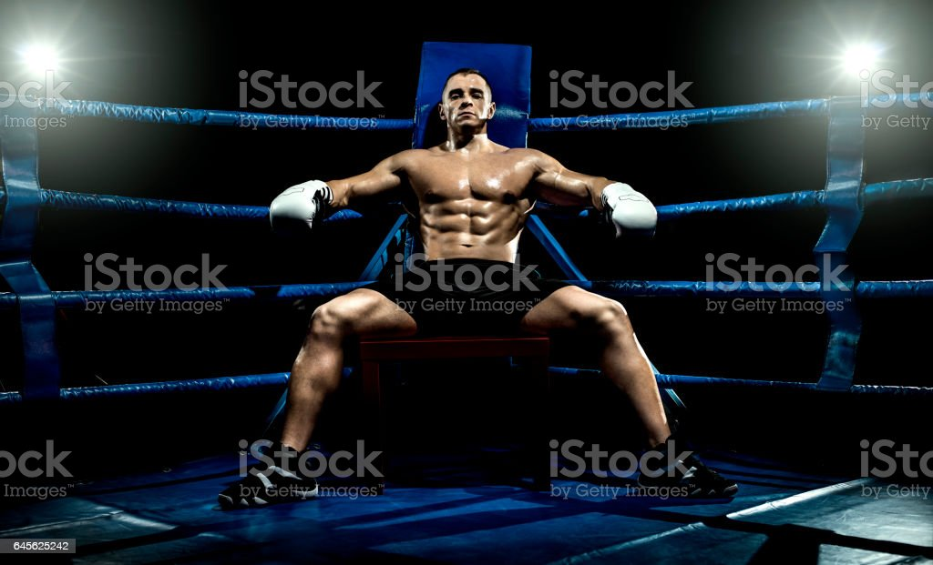 boxer on boxing ring, tired time-out stock photo