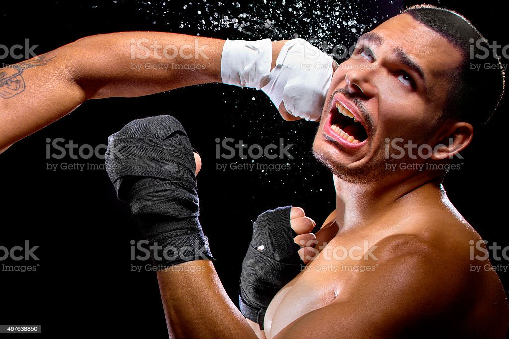 Boxer or MMA Fighter Getting Hit in the Face stock photo