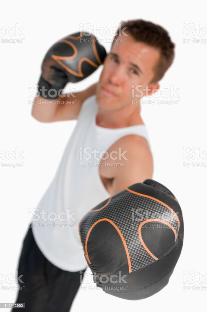 Boxer performing an uppercut stock photo