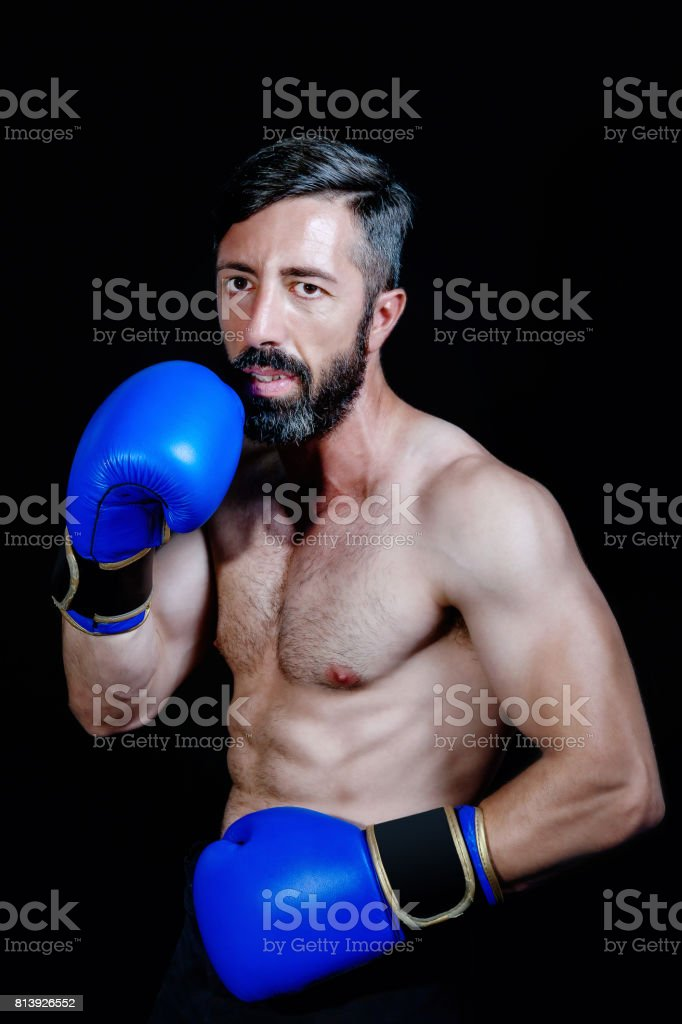 Boxer portrait in half bust, looks at the camera. stock photo