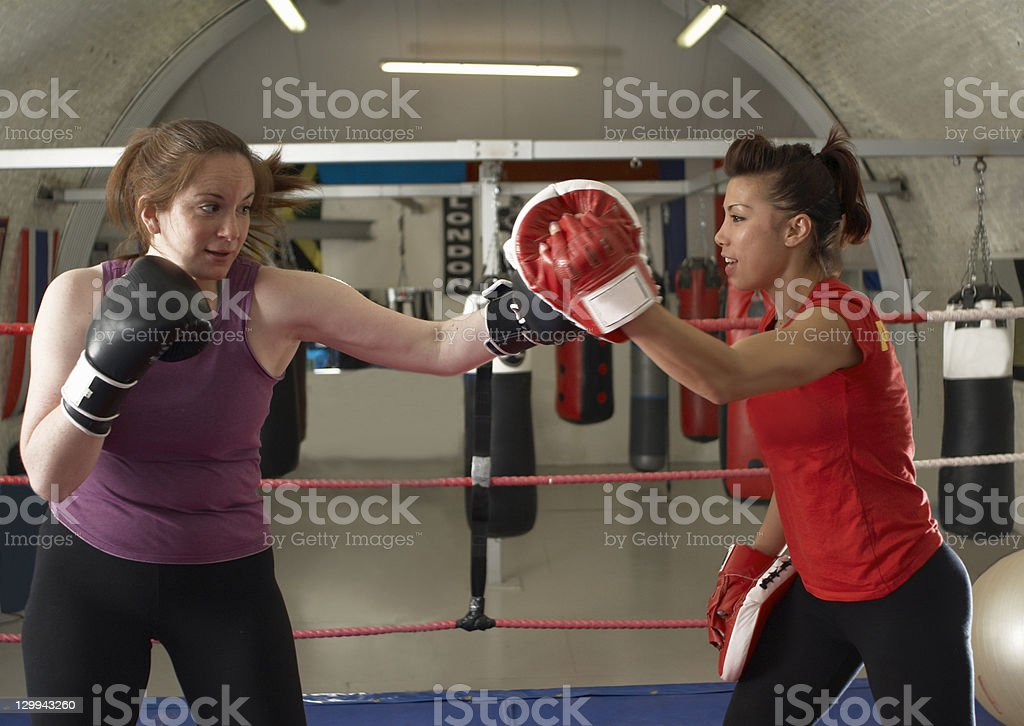 Boxer training with coach in gym stock photo