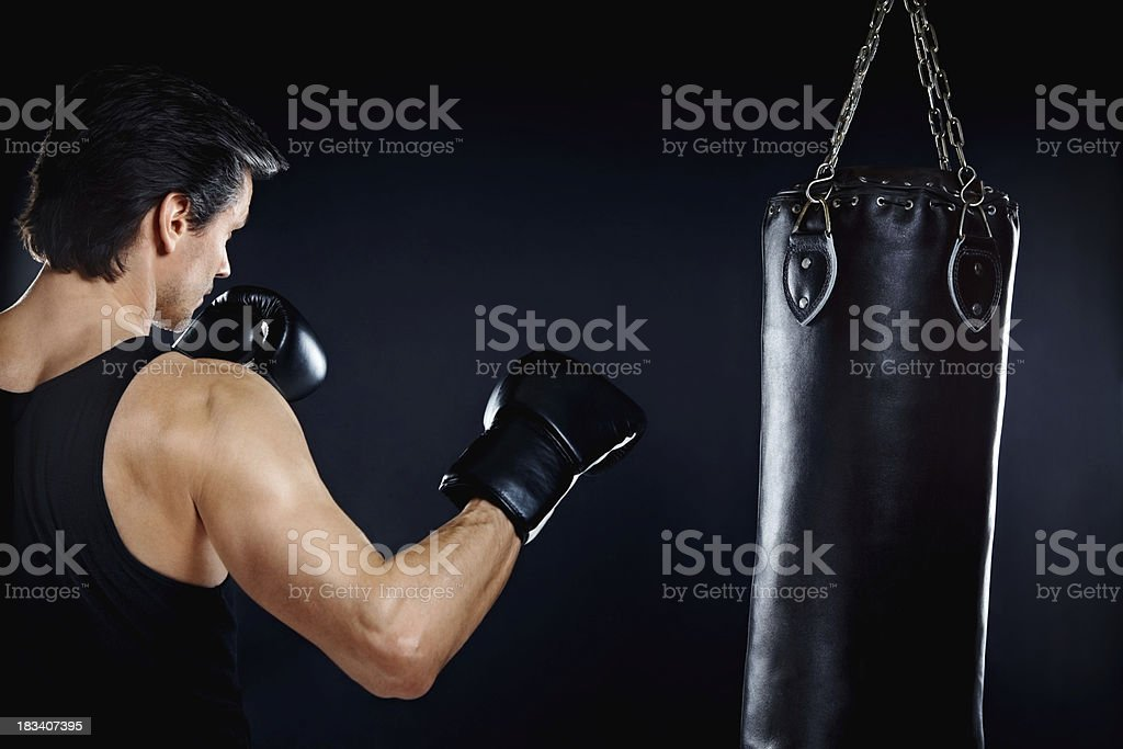 Boxer training with punching bag stock photo
