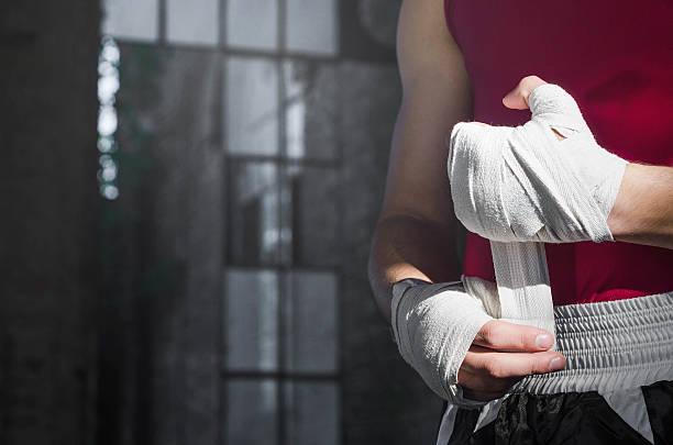 Boxer turning bandages stock photo