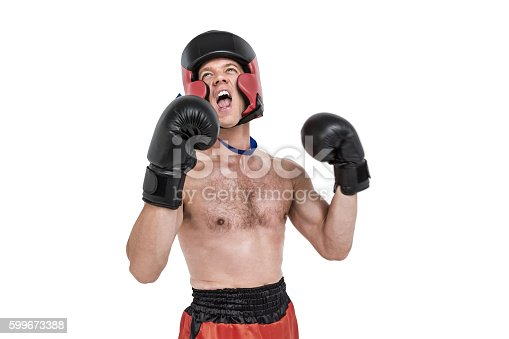 istock Boxer wearing medal performing boxing stance 599673388