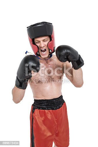istock Boxer wearing medal performing boxing stance 599673434
