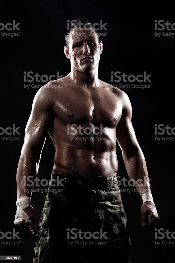 Boxer with dramatic studio lighting royalty-free stock photo