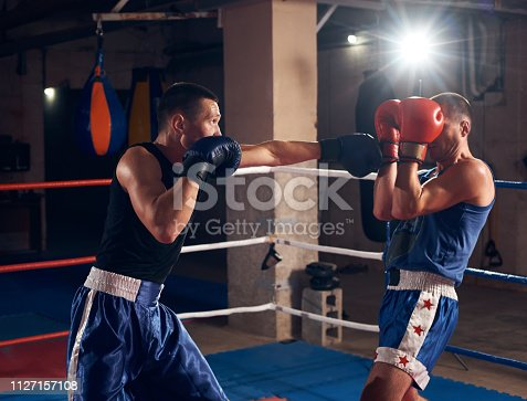 istock Boxers training kickboxing in the ring at the health club 1127157108