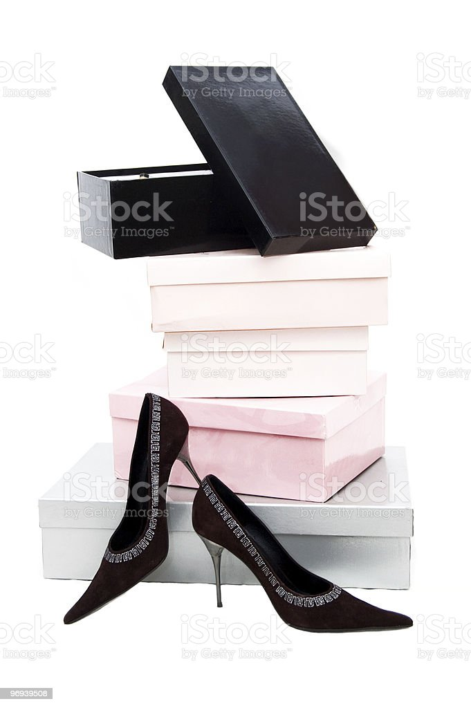 Boxes and woman shoes royalty-free stock photo