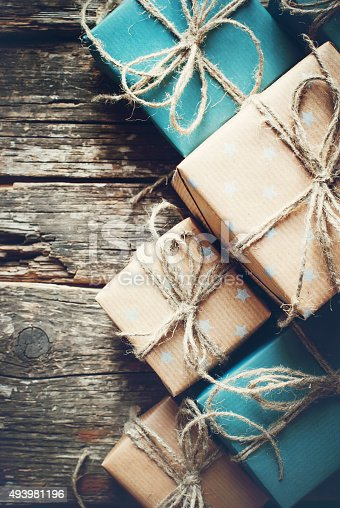 493890050 istock photo Boxes are Packed into a Brown Paper with Linen Cord 493981196