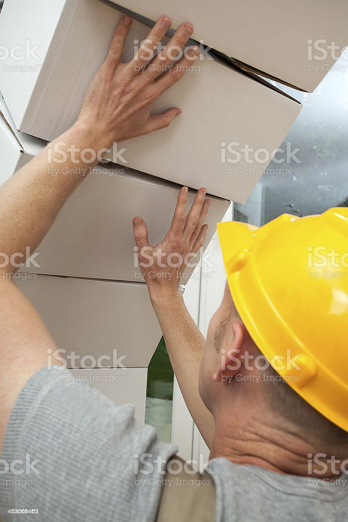 Boxes falling on worker stock photo