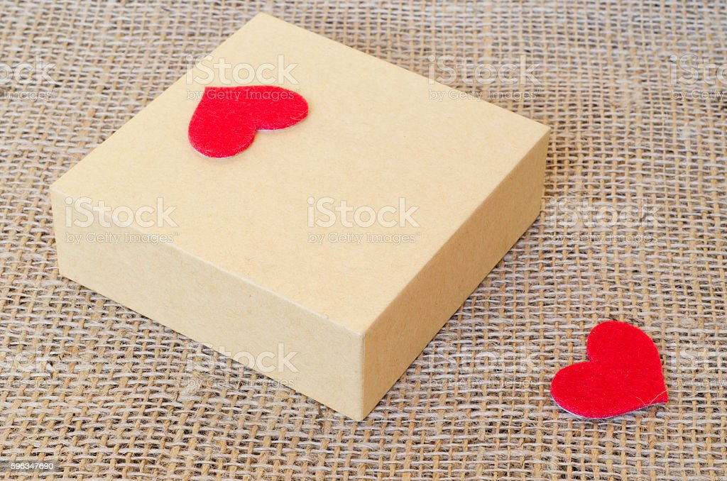 Boxes for gifts and paper heart on the sackcloth Lizenzfreies stock-foto