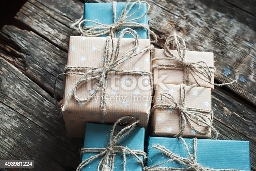 493890050 istock photo Boxes in Brown Blue  Paper with Cord on Wooden Background 493981224