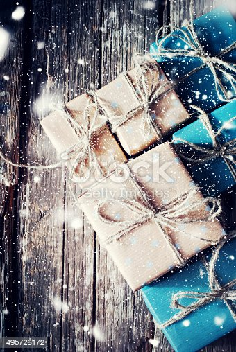 493890050 istock photo Boxes in Paper with Linen Cord. Effect Drawn Snow 495726172