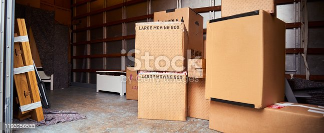 Large moving boxes inside removal van ready to be stacked up and secured