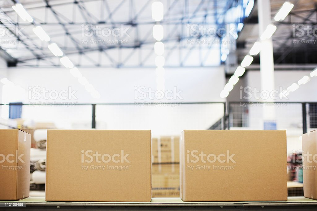 Boxes in row in shipping area stock photo